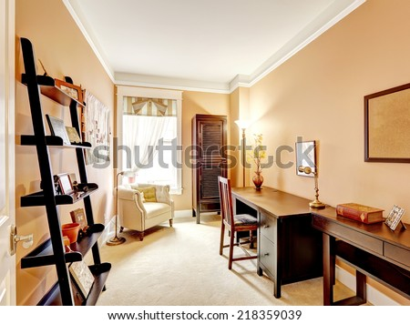 Beige tone office room with wooden furniture - stock photo