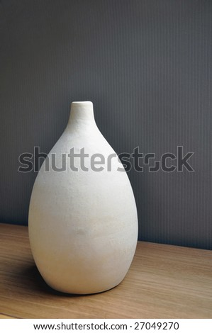 Beige vase in ceramic used as room decoration. - stock photo