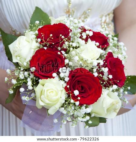 beige wedding bouquet at bride's hands - stock photo