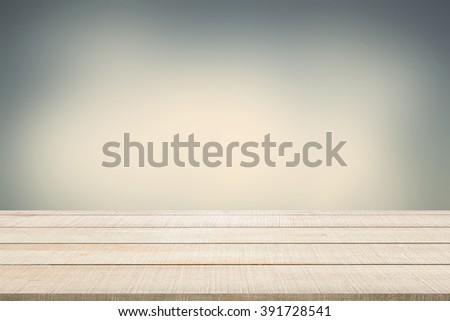 Beige wood table top panel on retro blurred background in dark tone with gray (grey), cream, and light brown, use for display or montage products for advertisement in mystery concept - stock photo