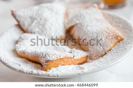 Beignets on Plate with powdered sugar