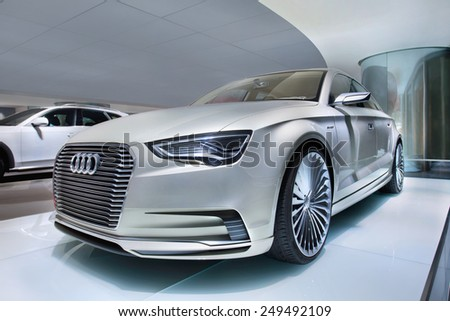 BEIJING-APRIL 16, 2013. Audi E-Tron in showroom. In recent years non-German global brands like Cadillac, Lexus and Infiniti challenged the grip Audi, BMW and Mercedes-Benz maintain on China's market. - stock photo