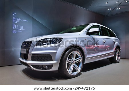 BEIJING-APRIL 16, 2013. Audi Q7 in a showroom. In recent years non-German global brands like Cadillac, Lexus and Infiniti challenged the grip Audi, BMW and Mercedes-Benz maintain on China's market. - stock photo