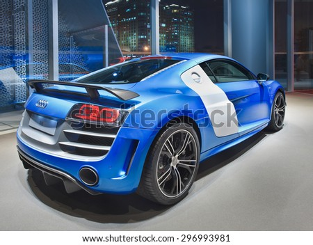 BEIJING-APRIL 17, 2013. Blue Audi R8 in a showroom. It is a mid-engine, 2-seater sports car, based on Lamborghini Gallardo platform, equipped whit Audi's quattro permanent all-wheel drive system. - stock photo