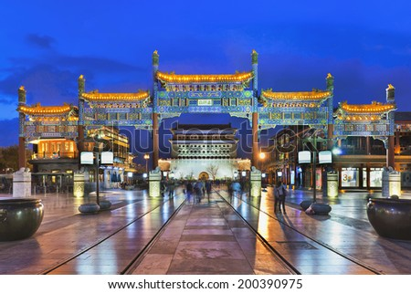 BEIJING-APRIL 24, 2013. Famous Qianmen Street at twilight. It is 840 meters long and 21 meters wide and has a history of over 570 years. Its buildings style resemble the late Qing Dynasty (1644-1911). - stock photo