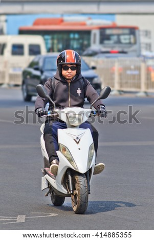 BEIJING-APRIL 28, 2016. Junyue electric scooter. Many electric bikes in China are scooter style e-bike that may or may not have pedals. The Chinese electric bike market is the largest in the world. - stock photo