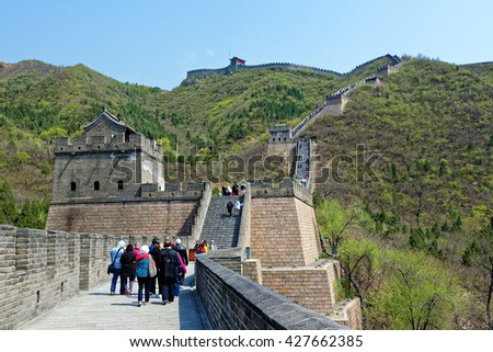 BEIJING - April 10, 2016:Juyongguan Great Wall, is built in 1368 of the Ming Dynasty and has been repaired in 1992. Unlike other continuously parts, Juyongguan great wall is a circle of 4,142 meters - stock photo