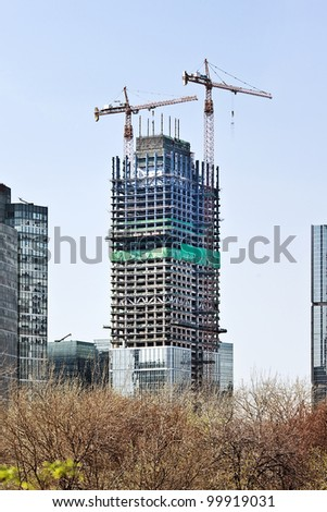 BEIJING-APRIL 13, 2012. Skyscrapers under construction on April 13, 2012. China has a booming skyscraper industry. Currently 34% of the worlds tallest buildings are located in China. - stock photo