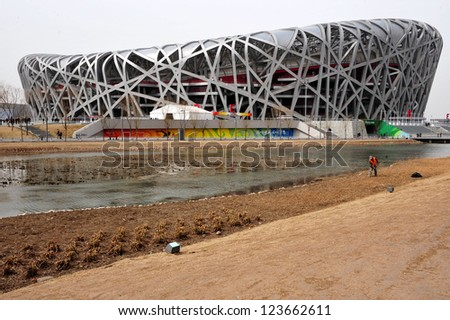 BEIJING - APRIL 04: The Bird's Nest Stadium at the Olympic Green park on April 04 2009 in Beijing, China.The birds nest can withstand an earthquake of up to magnitude 8 on the Richter Scale. - stock photo