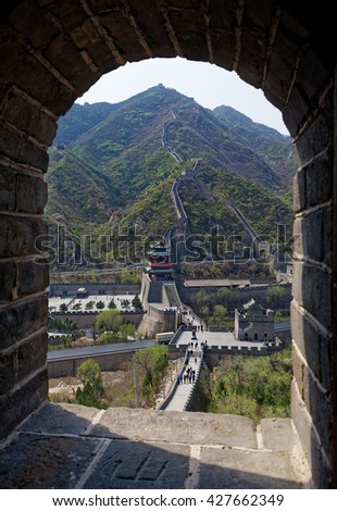 BEIJING - April 10, 2016:The Great Wall of China at Juyongguan in the Jundu Mountains at Juyong Pass, view from the watchtower window.  - stock photo