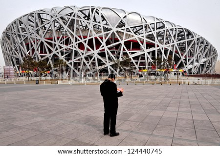 BEIJING - APRIL 04:Visitors at the Bird's Nest Stadium on April 04 2009 in Beijing, China.Beijing National Stadium is believed to be the world's largest enclosed space. - stock photo