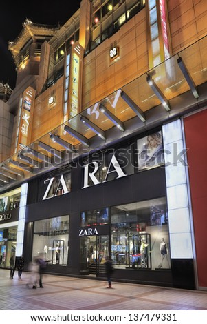 BEIJING-APRIL 14. Zara outlet at night. Zara owner, Spain Inditex, has reported annual profits of $2.6 billion up 11% on the previous year. It has now 5,527 stores worldwide. Beijing, April 14, 2013. - stock photo