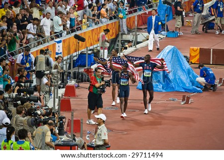 BEIJING - AUG 18: Angelo Taylor Kerron Clement and Bershawn Jackson take a victory lap. USA sweeps men's 400 meter hurdles gold silver and bronze at the Summer Olympics. Beijing, China August 18, 2008