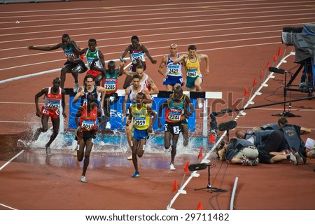 BEIJING - AUG 16: Athletes competing in Men's 3000 meter steeplechase race inside the Bird's Nest stadium during the 2008 Summer Olympics. August 16, 2008 Beijing, China