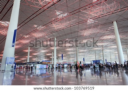 BEIJING AUG. 28, 2010. Departure hall Beijing Capital Airport Terminal 3 on Aug. 29, 2010. The airport registered 488,495 aircraft movements (take-offs + landings) and ranked 10th in the world. - stock photo