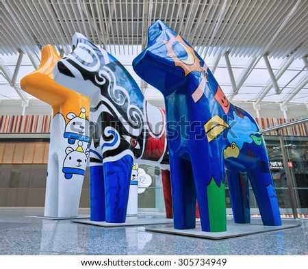BEIJING-AUG. 2, 2015. Horse sculptures at Livat shopping mall. The mall is owned by Swedish Ikea Group and shoppers will experience Scandinavian design like DALA horse, the national symbol of Sweden. - stock photo