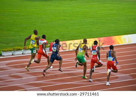 BEIJING - AUG 18: Usain Bolt trails the pack before setting a new world record for men's 100 meter sprint at the 2008 Summer Olympic Games. August 18, 2008 Beijing, China - stock photo