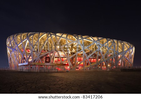 BEIJING - AUGUST 16. Bird's nest at night time at August 16,2011. the Bird's Nest is a stadium in Beijing, China. It was designed for use throughout the 2008 Summer Olympics and Paralympics. - stock photo