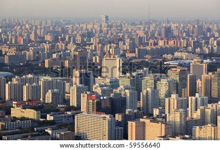 BEIJING - AUGUST 22: Cityscape of Beijing city at dusk on August 22, 2010 in Beijing, China. Beijing is the Capital of China, the second-largest economy in the World. - stock photo