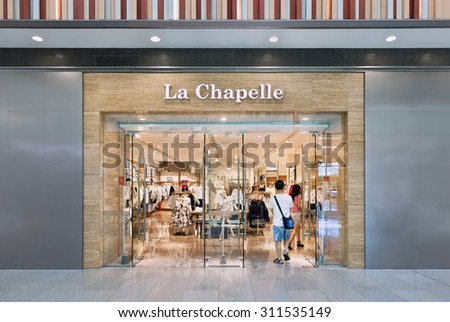 BEIJING-AUGUST 21, 2015. Front of La Chapelle outlet. A major women's fashion group in China with 1,400 stores and turnover of 2 billion RMB. Founder Xing Jiaxing typifies new Chinese retail heroes.  - stock photo