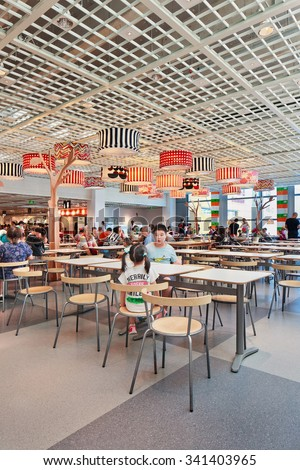BEIJING-AUGUST 21, 2015. IKEA restaurant at LIVAT shopping mall. The newly opened mega mall is owned by Swedish IKEA Group and shoppers will experience a uniquely designed Scandinavian interior. - stock photo