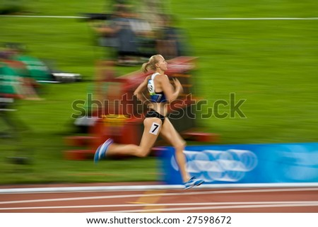 BEIJING - AUGUST 18 : Olympic athlete Kaie Kand from Estonia runs in the Women's Heptathlon 800 m at the 2008 Summer Olympic August 18, 2008 in Beijing, China.