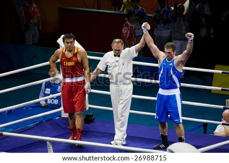 BEIJING - AUGUST 24: Roberto Cammarelle of Italy defeats Zhilei Zhang of China to win the gold in the Men's Super Heavyweight boxing final, August 24, 2008 Beijing, China