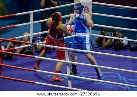 BEIJING - AUGUST  24: Roberto Cammarelle of Italy knocks out Zhilei ZHANG of China and goes on to win the gold in the Men's Super Heavyweight boxing final August 24, 2008 in Beijing, China.