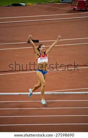 BEIJING - AUGUST 18:  Russia's Yelena Isinbayeva celebrates breaking the world record to win the women's pole vault at Summer Olympics August 18, 2008 in Beijing, China.