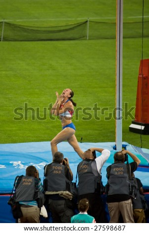 BEIJING - AUGUST 18: Russia's Yelena Isinbayeva seconds after breaking the women's pole vault world record and winning the old medal at the Summer 2008 Olympic games in Beijing, China August 18, 2008.