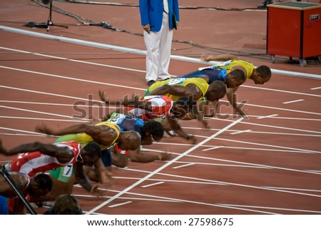 BEIJING - AUGUST 18: Start of Men's 100 meter sprint race where Usain Bolt sets a new world record at the 2008 Summer Olympic August 18, 2008 in Beijing, China. - stock photo