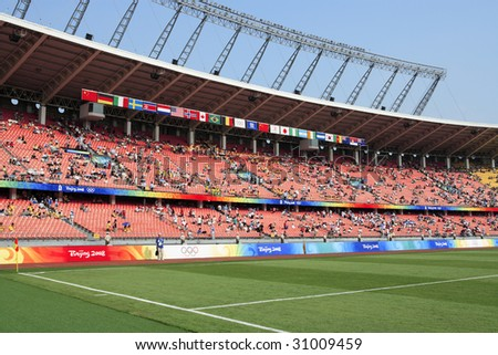 BEIJING - AUGUST 12:  Workers' Stadium fills with spectators before a match between Brazil and Nigeria at the Beijing Olympic Games women's soccer tournament August 12, 2008 in Beijing, China. - stock photo