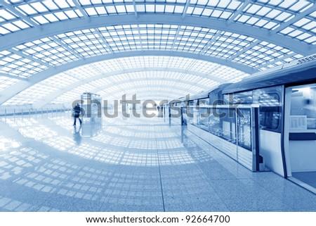 Beijing capital international airport passenger train and tourists - stock photo