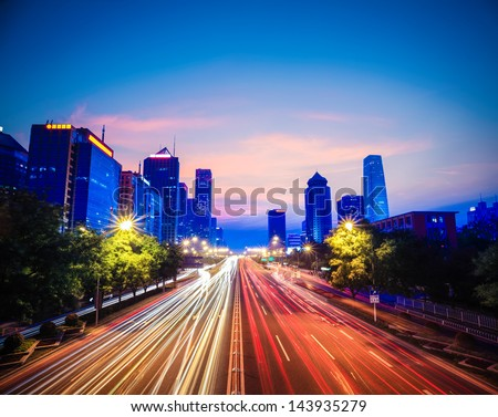 beijing central business district with traffic in nightfall,China - stock photo