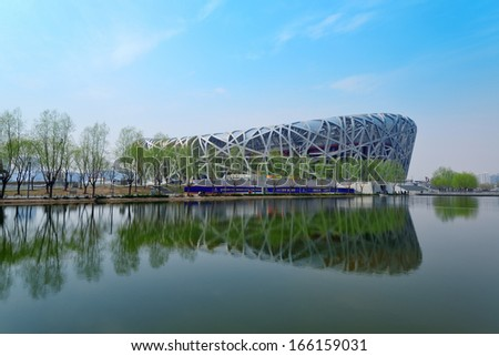 BEIJING, CHINA - APR 7: Beijing National Stadium with blue sky on April 7, 2013 in Beijing, China. The stadium was established for the 2008 Summer Olympics and Paralympics. - stock photo