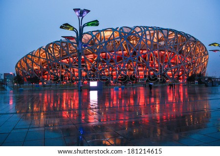 BEIJING,CHINA - APRIL 01 , 2011 : Bird's Nest is a Beijing National Stadium at night in Beijing, China. The stadium was established for the 2008 Summer Olympics and Paralympics. - stock photo