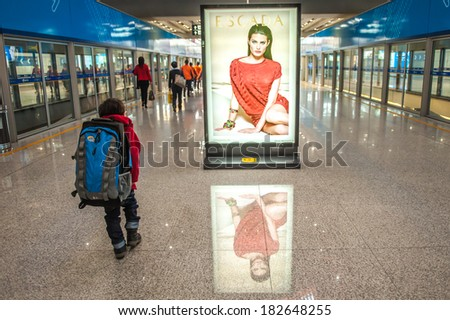 BEIJING,CHINA - APRIL 02 , 2011 : Passengers at departure hall Beijing Capital Airport in China.The airport has registered 488,495 aircraft movements and ranked 10th in the world. - stock photo