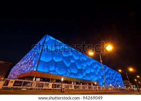 BEIJING, CHINA-APRIL 13 : The Water Cube Stadium built with new material ETFE, symbol of modern China design, glowing at night on April 13,2010 in Beijing, China - stock photo