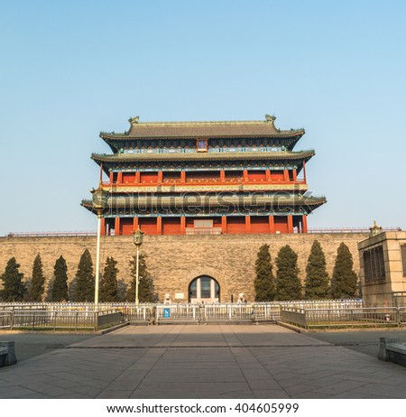 Beijing, China at the Zhengyangmen Gatehouse in Tiananmen Square. Beautiful historical building at sunset. - stock photo