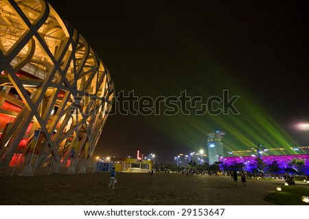 BEIJING, CHINA - Aug 18: Nighttime light show at the Olympic green featuring the Bird?s Nest Stadium and the Water Cube August 18, 2008 Beijing, China