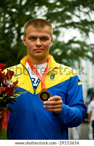 BEIJING, CHINA  - Aug 24: Vyacheslav Glazkov of Ukraine shows his bronze medal from super heavyweight boxing division at the 2008 Olympic games August 24, 2008 Beijing, China.