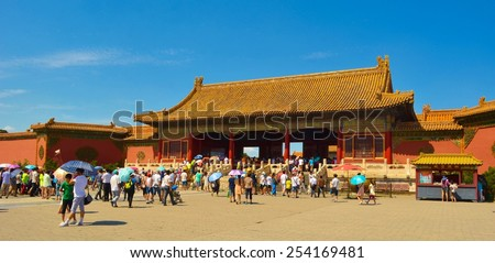 BEIJING, CHINA, AUGUST 21, 2013: People are walking through forbidden city palace complex in beijing. - stock photo
