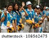 BEIJING, CHINA - AUGUST 24, 2008: Unidentified Olympic volunteers during summer Olympics on August 24, 2008 in Beijing, China. For illustration, comparison and recollection of previous games - stock photo