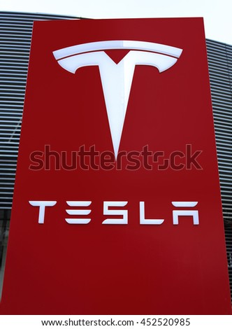 BEIJING, CHINA - FEBRUARY 27, 2016: Tesla sign. Tesla Motors, Inc. is an American company founded in 2003. It is in the industry of the Automotive, Renewable Energy Storage Systems. - stock photo