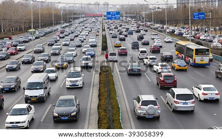 BEIJING, CHINA-FEBRUARY 27, 2016: Traffic jam at fourth ring road in downtown city. - stock photo