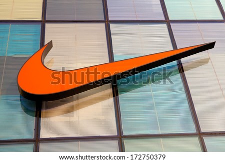 BEIJING, CHINA -JAN 22, 2014: Nike shop sign; Nike is an American multinational corporation, a major manufacturer of sports equipment, with revenue in excess of US$24.1 billion in its fiscal year 2012 - stock photo