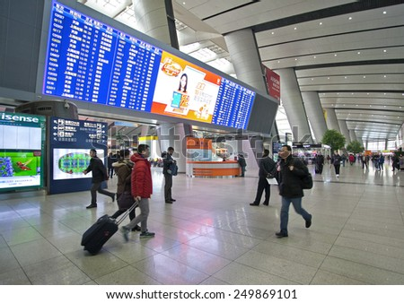 BEIJING, CHINA-JAN. 29, 2015: Passengers are seen at the Beijing South Railway station. Around 2.807 billion trips are expected to be made by people during China's Spring Festival travel rush. - stock photo