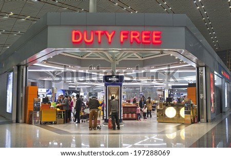 BEIJING, CHINA-JAN.23, 2014: People seen at a Duty free shop at Beijing Capital International Airport. As of 2014, this airport is the busiest airport in the world in terms of passenger throughput  - stock photo