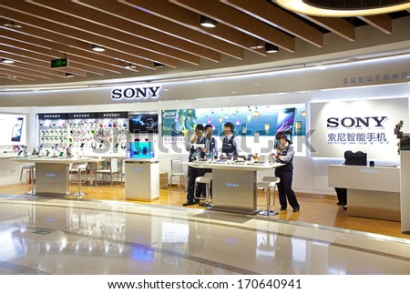 BEIJING, CHINA - JANUARY 2, 2014: People seen at a Sony store; Sony PlayStation 4 sales topped 2.1 million as of Dec.1. Sony expects to sell 5 million PlayStation 4's by the end of March. - stock photo