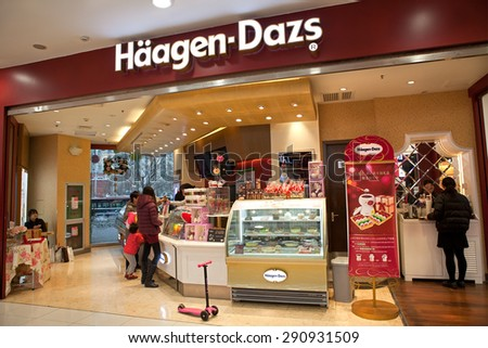 BEIJING,CHINA-JANUARY 24,2015:  Unidentified people is seen at a Haagen-Dazs store; Haagen-Dazs is an ice cream brand established in 1961. It has has franchises around the world - stock photo